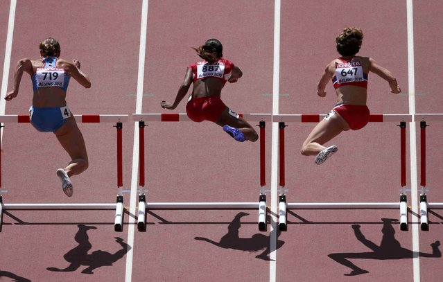 Ekaterina Galitskaia of Russia (L), Kendra  Harrison of the U.S. and Isabelle Pedersen of Norway compete in the women's 100 metres hurdles heats during the 15th IAAF World Championships at the National Stadium in Beijing, China August 27, 2015. (Photo by Dylan Martinez/Reuters)