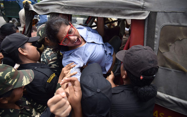An activist of the Communist Party of India (Marxist) is forcefully carried away by police personnel during a protest against the Indian government decision to privatise 12 oil fields in Assam, in Guwahati on July 15, 2016. Eleven political parties of Assam protested against the privatisation of 12 oil fields in Assam. The share of the Northeast to India's total oil production and gas production in 2014-15 was 12.1% and 12.2%, respectively. The total production of oil in 2014-15 was 4.54 million metric tonne (MMT) and gas production was 4.13 billion cubic metres (BCM). (Photo by Biju Boro/AFP Photo)