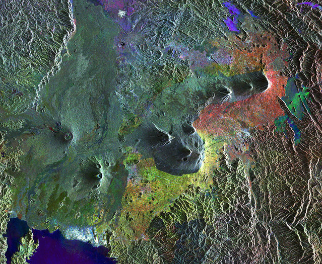 These are the Virunga Mountains in Rwanda, a dangerous chain of active volcanoes. (Photo by The European Space Agency)