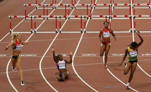 Danielle Williams (R) of Jamaica crosses the finish line in front of Cindy Roleder of Germany (L), Tiffany Porter of Britain (2ndL) and Sharika Nelvis of the U.S. (2ndR) to win the women's 100 metres hurdles final during the 15th IAAF World Championships at the National Stadium in Beijing, China, August 28, 2015. (Photo by David Gray/Reuters)
