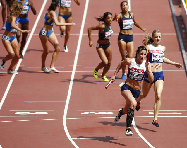 Seren Bundy-Davies of Britain (2nd R) runs after receiving the baton from teammate Kirsten McAslan (R) during their women's 4 x 400 metres relay heat at the 15th IAAF Championships at the National Stadium in Beijing, China August 29, 2015. (Photo by David Gray/Reuters)