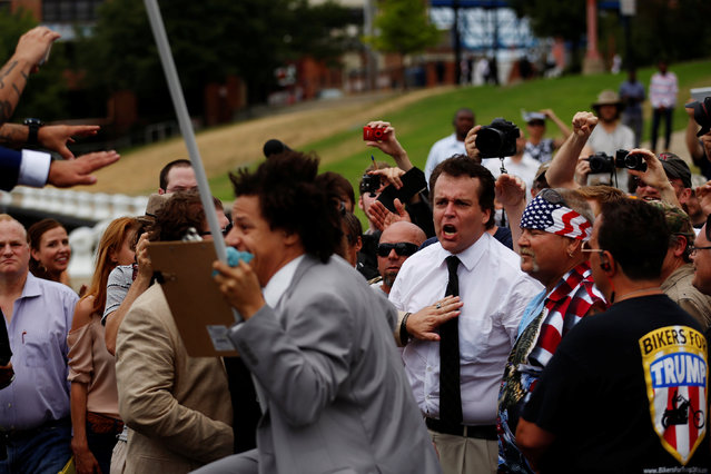 A Trump supporter screams at Eric Andre during a support rally near the Republican National Convention in Cleveland, Ohio, U.S., July 18, 2016. (Photo by Lucas Jackson/Reuters)