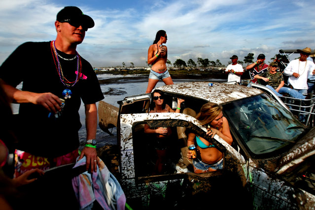 The mud bog is party central throughout the day. (Photo by Gary Coronado/The Palm Beach Post)