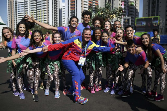 Members of the Venezuelan delegation pose with volunteers during the teams welcome ceremony inside the Olympic Village in Rio de Janeiro, Brazil on August 1, 2016. (Photo by Edgard Garrido/Reuters)