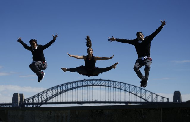 Members of the Red Bull Flying Bach dance troupe perform on Sydney Harbour's Fort Denison during a photo call, in Sydney September 9, 2014. The group, in Australia as part of their world tour, perform acrobatic dance to the classical music of German composer Johann Sebastian Bach with combined with electronic beats. Pictured are (L-R) Nordine-Dany Grimah, Anna Holmstrom and Yamine Manaa. (Photo by Jason Reed/Reuters)