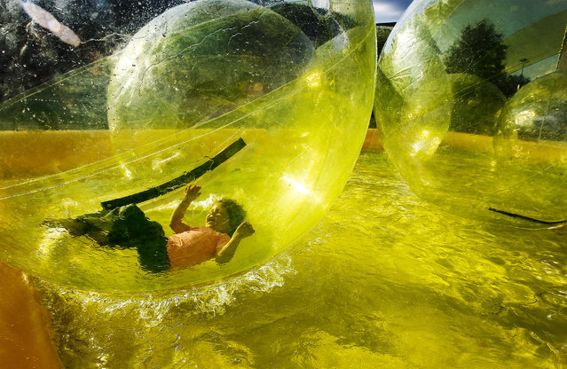 McKinlee Roberts, 4, plays in the Walk on Water Bubbles during opening day of the 158th Annual Mid-South Fair at The Landers Center in Southaven, Miss. Friday, September 19, 2014. As of late the fair has found a home in Mississippi were thousands of people from all over the mid-south enjoy the fun filled action the fair offers during its 10-day run. (Photo by Mark Weber/AP Photo/The Commercial Appeal)
