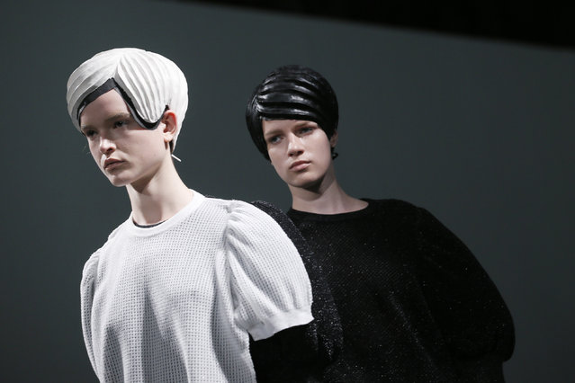 Models present creations by Japanese designer Kunihiko Morinaga as part of her Spring/Summer 2015 women's ready-to-wear collection for fashion house Anrealage during Paris Fashion Week September 23, 2014. (Photo by Gonzalo Fuentes/Reuters)