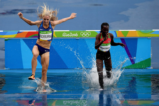 Emma Coburn of the United States and Hyvin Kiyeng Jepkemoi of Kenya compete in the Women's 3000m Steeplechase final on Day 10 of the Rio 2016 Olympic Games at the Olympic Stadium on August 15, 2016 in Rio de Janeiro, Brazil. (Photo by Shaun Botterill/Getty Images)