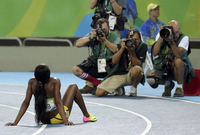 2016 Rio Olympics, Athletics, Final, Women's 200m Final, Olympic Stadium, Rio de Janeiro, Brazil on August 17, 2016. Photographers take pictures of Elaine Thompson (JAM) of Jamaica after she won the gold. (Photo by Gonzalo Fuentes/Reuters)