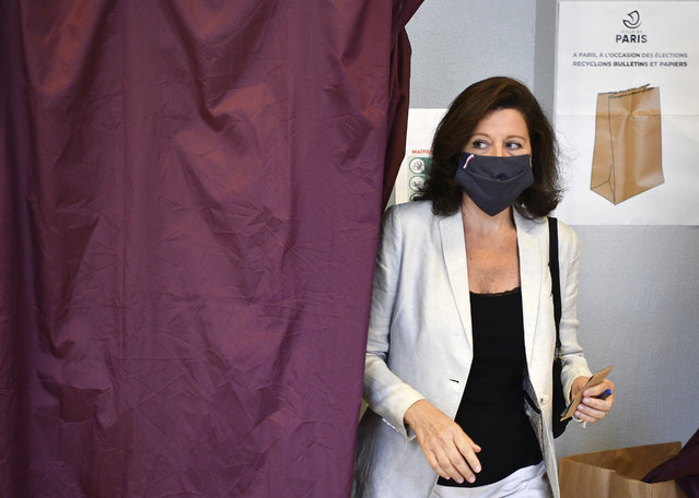 Agnes Buzyn, candidate for the presidential party La Republique en Marche (LREM) in the second round of municipal elections, leaves the voting booth before voting Sunday, June 28, 2020 in Paris. France is holding the second round of municipal elections in 5,000 towns and cities Sunday that got postponed due to the country's coronavirus outbreak. (Photo by Christophe Archambault, Pool via AP Photo)