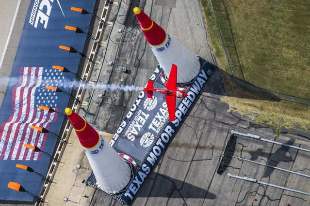 Pete McLeod of Canada performs during the finals for the sixth stage of the Red Bull Air Race World Championship at the Texas Motor Speedway in Fort Worth, Texas, United States on September 7, 2014. (Photo by Garth Milan/Red Bull)