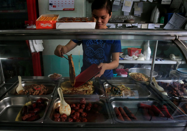A worker prepares an order at a small restaurant in Metro Manila, Philippines, August 4, 2016. (Photo by Romeo Ranoco/Reuters)