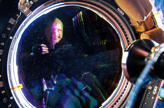 An astronauts selfie. Pettit photographed himself reflected in a window on board the International Space Station. (Photo by Donald R. Pettit)