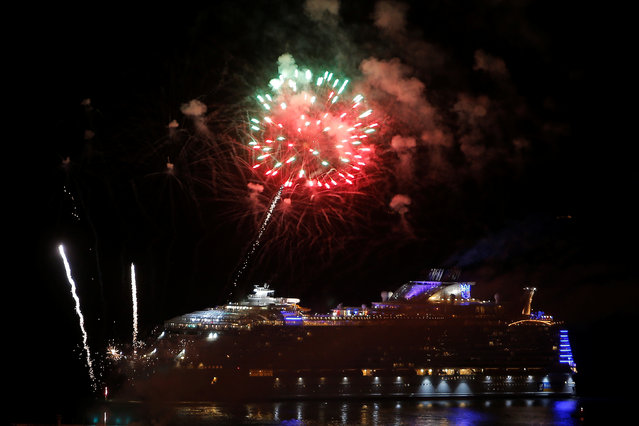 Fireworks light up the night sky over the world's largest cruise ship of Royal Caribbean Cruises, the 362-metre-long Symphony of the Seas, after its world presentation ceremony, while sailing to Barcelona from a port in Malaga, Spain on March 27, 2018. (Photo by Jon Nazca/Reuters)