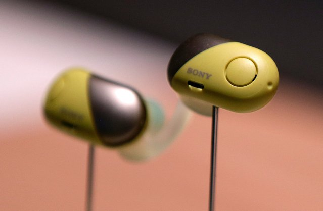 Sony WF-SP700N noise-canceling earphones are on display after a Sony news conference at CES International, Monday, January 8, 2018, in Las Vegas. (Photo by John Locher/AP Photo)