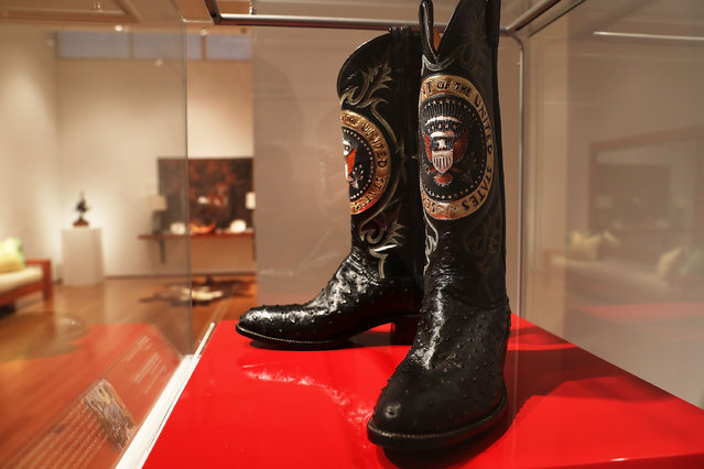 "A pair of Ronald Reagan's cowboy boots sit in a case at Christie's where items from the former president and Nancy Reagan's California home are to be auctioned shortly on September 16, 2016 in New York City. Many personal items of the first couple are to be auctioned including ""Hollywood Regency""style furniture and light fixtures, decorative works, handbags, porcelain stamped with the presidential seal, jewelry and a pair of Reagan's cowboy boots with the presidential seal. The e-catalog auction, which is expected to generate more than $2 million with individual items ranging from $1,000 to $50,000, goes live at Christie's Monday in New York. Proceeds from the auction will be donated to the Ronald Reagan Presidential Foundation and Institute. (Photo by Spencer Platt/Getty Images)"
