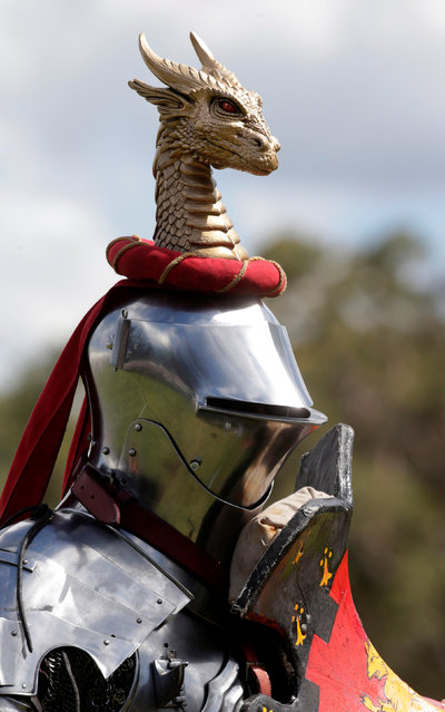 Australian jouster Philip Leitch wears a dragon on his helmet during a jousting tournament at the St Ives Medieval Fair in Sydney, one of the largest of its kind in Australia, September 24, 2016. (Photo by Jason Reed/Reuters)