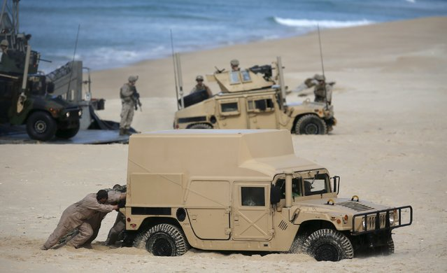 NATO soldiers attend a NATO military exercise at Raposa beach, near Setubal, Portugal October 20, 2015. NATO and its allies opened their largest military exercise in more than a decade on Monday, choosing the central Mediterranean to showcase strengths that face threats from Russia's growing military presence from the Baltics to Syria. (Photo by Rafael Marchante/Reuters)