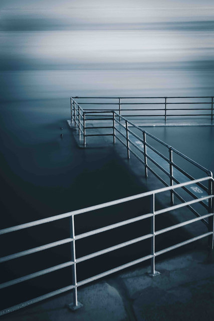 "Shoalstone Pool, Devon. Your View youth category winner. ""I took this at Shoalstone outdoor pool in Brixham, south Devon at 5.00am in 2019. I needed to take the picture at high tide and also with the early morning sea mist"". (Photo by Adam Furneaux/UK Landscape Photographer of the Year 2020)"