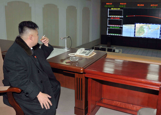 North Korean leader Kim Jong-Un smokes a cigarette at the General Satellite Control and Command Center after the launch of the Unha-3 (Milky Way 3) rocket carrying the second version of Kwangmyongsong-3 satellite at West Sea Satellite Launch Site in Cholsan county, on December 12, 2012, in this picture released by the North's KCNA news agency in Pyongyang December 13, 2012. (Photo by Reuters/KCNA)