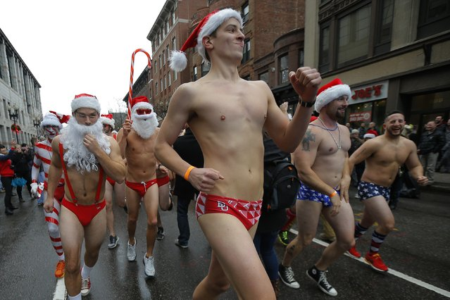 Participants begin running at the starting line for the 15th annual Santa Speedo Run, a charity run through the streets of the Back Bay, in Boston, Massachusetts December 6, 2014. (Photo by Brian Snyder/Reuters)