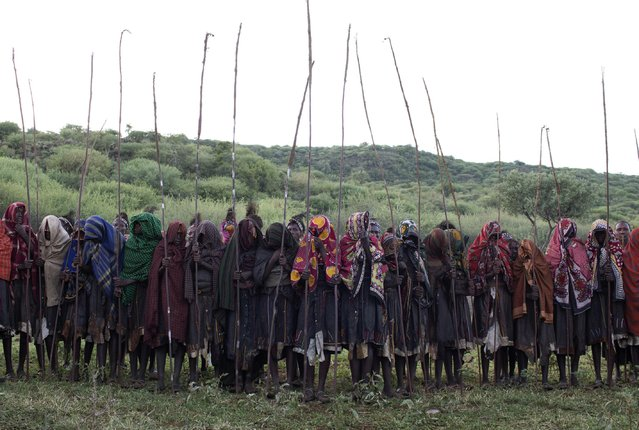 Pokot girls take part in an initiation ceremony marking their passing over into womanhood, about 80 km (50 miles) from the town of Marigat in Baringo County December 6, 2014. (Photo by Siegfried Modola/Reuters)