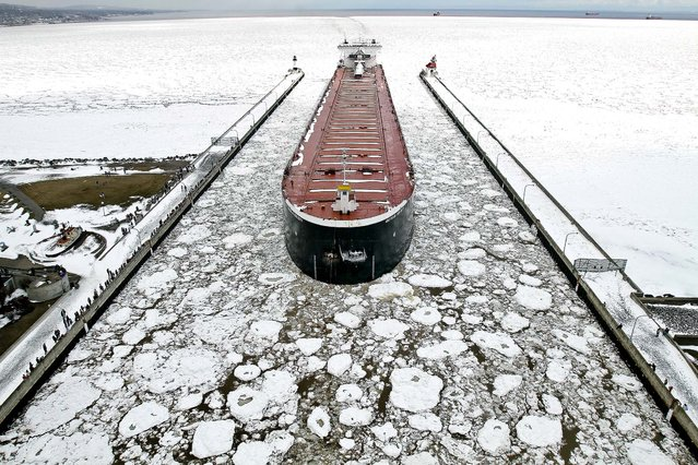 The American Integrity enters the Duluth ship canal after ice on Lake Superior blocked access to the Duluth Superior harbor, causing nine ships to wait at anchor in the open lake until ice breaking operations could open a lane for the traffic, on April 13, 2013. (Photo by Clint Austin/Duluth News Tribune)