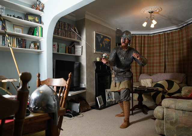 Matt Town of the st Centingas historic re-enactment group poses for portraits in his home while wearing his replica Saxon armour on October 12, 2016 in Ramsgate, England. (Photo by Leon Neal/Getty Images)