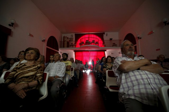 Projectionist Antonio Feliciano, 75, shows a film during a projection in Monforte, Portugal May 16, 2015. (Photo by Rafael Marchante/Reuters)