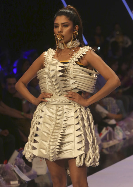 A model presents creation by Pakistani designer Hassan Riaz during the Fashion Pakistan Week, Spring/Summer in Karachi, Pakistan, Tuesday, April 10, 2018. (Photo by Shakil Adil/AP Photo)