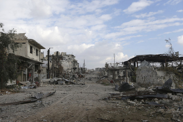 A general view shows damaged buildings along a deserted street in the rebel-held area of Jobar, a suburb of Damascus, December 22, 2014. (Photo by Bassam Khabieh/Reuters)