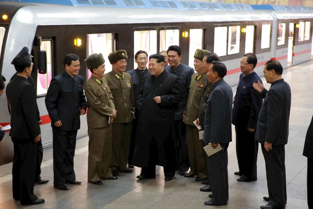 North Korean leader Kim Jong Un looks around a newly manufactured subway train at a station in Pyongyang in this undated photo released by North Korea's Korean Central News Agency (KCNA) on November 20, 2015. (Photo by Reuters/KCNA)