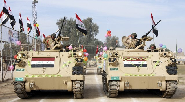 Iraqi soldiers ride in military vehicles at a parade during the Iraqi Army Day celebration in Kerbala, southwest of Baghdad,  January 6, 2015. (Photo by Mushtaq Muhammed/Reuters)