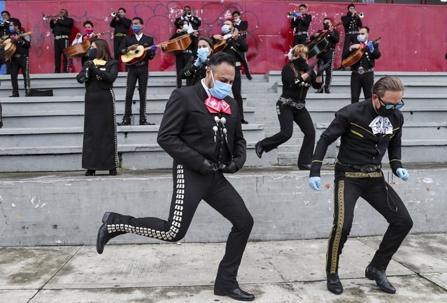 Musicians from Mariachi groups perform during an event to ask authorities to allow them to work on the upcoming Mother's Day in Quito, Ecuador, Tuesday, May 5, 2020. The government ordered in mid-march a national lockdown to control the spread of the new coronavirus. (Photo by Dolores Ochoa/AP Photo)