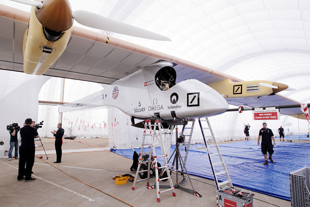 Solar Impulse, a solar-powered airplane with a wingspan of 208 ft, similar to a Boeing 747, is parked in its inflatable hangar at Lambert-St. Louis International Airport on Tuesday, June 4, 2013, in St. Louis. The airplane, which can fly day and night without fuel, uses solar power gathered from 11,628 silicon solar cells mounted on the wing and horizontal stabilizer to power four electric engines. Piloted by Bertrand Piccard and Andre Borschberg, the Solar Impulse is on a journey across America. (Photo by St. Louis Post-Dispatch, Erik M. Lunsford/AP Photo)