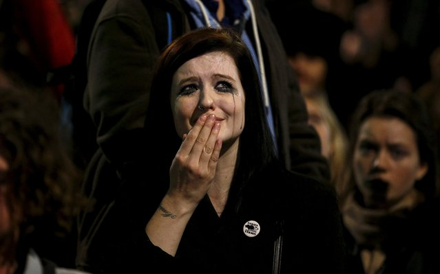 An anti-war protestor cries after the British parliament voted in favour of air strikes against militants in Syria, during a demonstration outside the Houses of Parliament in London, Britain, December 2, 2015. (Photo by Peter Nicholls/Reuters)