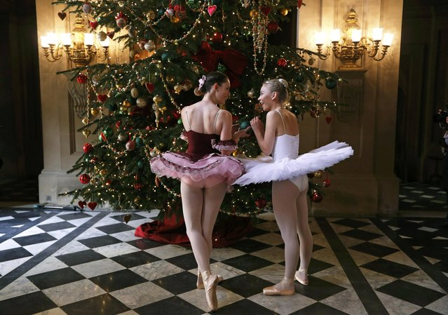 Dancers Daisy Kerry (R) and Alice Rathbone pose as characters from The Nutcracker, for the annual Christmas event at Chatsworth House near Bakewell in Britain November 4, 2016. (Photo by Darren Staples/Reuters)