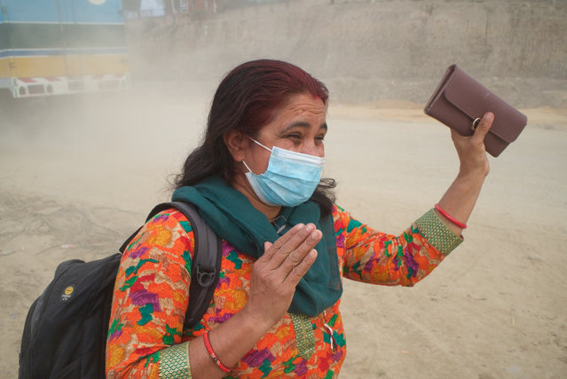 """Shova Regmi spends four hours a day commuting to and from work. """"It's very difficult now. My health is bad. It's like I'm suffocating. It creates a lot of stress, but it will be better in the future"""". (Photo by Pete Pattisson/The Guardian)"""