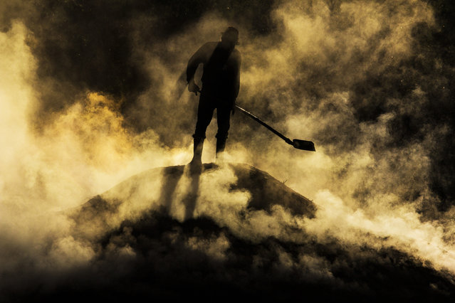 """""""Out from Hell"""". 6:00 am, near Biertan village, in Transylvania, worker preparing charcoal. Location: Romania. (Photo and caption by Razvan Teodoreanu/National Geographic Traveler Photo Contest)"""