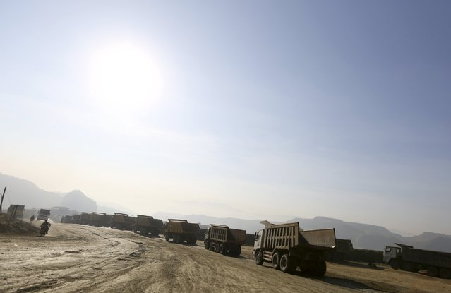 Trucks are seen at a jade stone mine dump at a Hpakant jade mine in Kachin state, Myanmar November 25, 2015. (Photo by Soe Zeya Tun/Reuters)