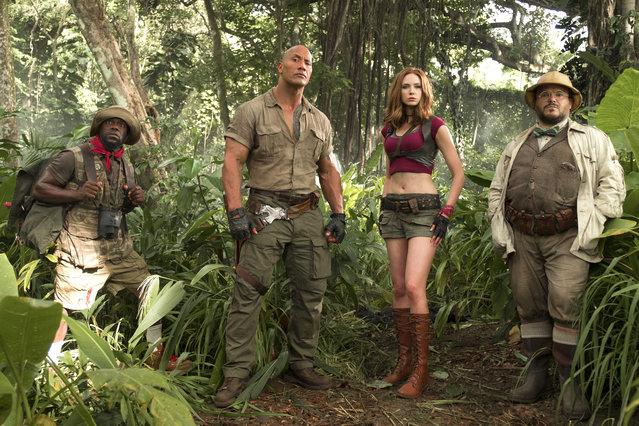 "This file image released by Sony Pictures shows Kevin Hart, from left, Dwayne Johnson, Karen Gillan and Jack Black in ""Jumanji: Welcome to the Jungle"".  ""Jumanji: Welcome to the Jungle"" outdid another weekend's worth of newcomers to top the North American box office for the third straight weekend, making the surprise hit the fifth-highest grossing film all time for Sony Pictures. (Photo by Frank Masi/Sony Pictures via AP Photo)"