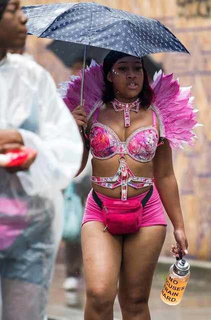 Revellers take part in the Notting Hill Carnival in London, Britain on August 26, 2018. (Photo by London News Pictures)