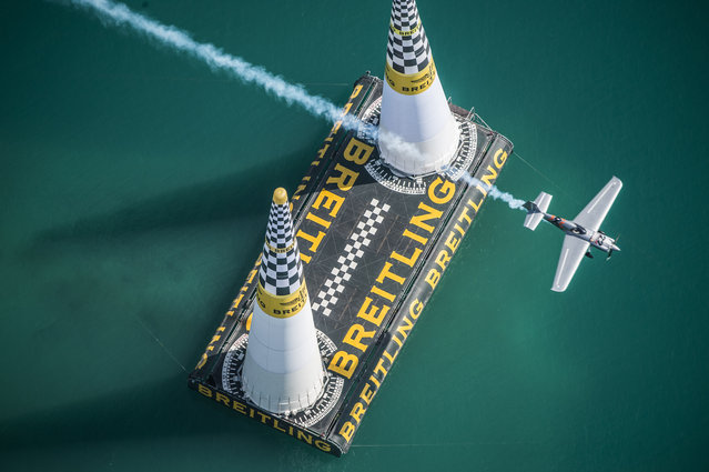 In this photo provided by Predrag Vuckovic via Global-Newsroom, Hannes Arch of Austria performs during the qualifying of the first stage of the Red Bull Air Race World Championship in Abu Dhabi, United Arab Emirates, Friday, February 13, 2015. (Photo by Predrag Vuckovic/AP Photo/Global-Newsro