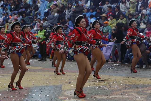 Caporal dancers perform during the carnival celebrations in Oruro, Bolivia, Saturday February 14, 2015. The Carnival of Oruro which is a religious festival dating back more than 2000 years in an ongoing pagan-catholic blend of religious practice in the region, and is one of UNESCO's Masterpieces of the Oral and Intangible Heritage of Humanity. (Photo by Juan Karita/AP Photo)