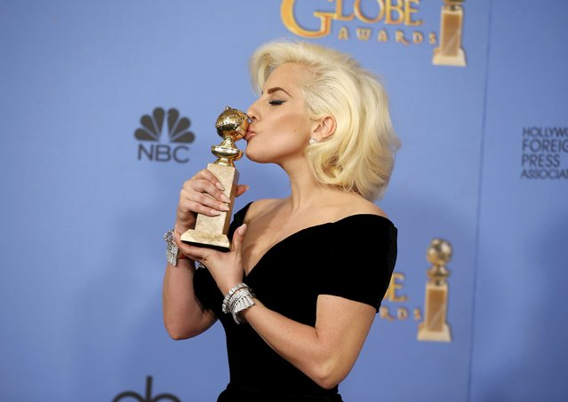 """Lady Gaga poses with the award for Best Performance by an Actress in a Limited Series or a Motion Picture Made for Television for her role in """"American Horror Story- Hotel"""" during the 73rd Golden Globe Awards in Beverly Hills, California January 10, 2016. (Photo by Lucy Nicholson/Reuters)"""