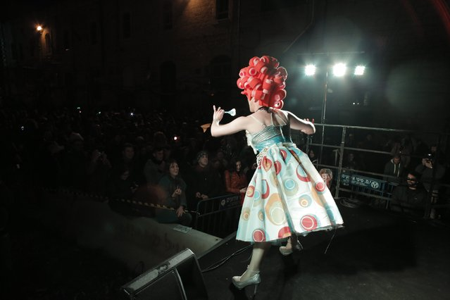 A drag queen performs on stage before the Drag Race in central Jerusalem, February 16, 2015. The Jerusalem LGBT (lesbian, gay bisexual and transgender) community organized a Drag Race in which competitors raced wearing high heels. (Photo by Ammar Awad/Reuters)