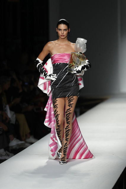 Model Kendall Jenner wears a creation as part of the Moschino women's 2019 Spring-Summer collection, unveiled during the Fashion Week in Milan, Italy, Thursday, September 20, 2018. (Photo by Antonio Calanni/AP Photo)
