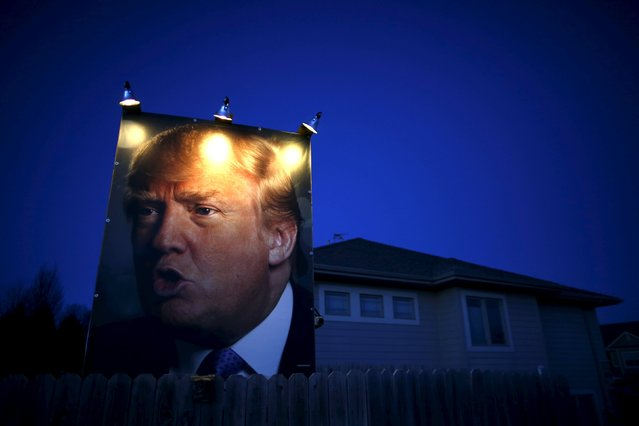 A picture of U.S. Republican presidential candidate Donald Trump hangs outside a house in West Des Moines, Iowa, United States, January 15, 2016. (Photo by Jim Young/Reuters)