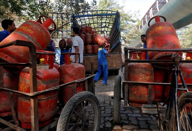 Workers load liquefied petroleum gas (LPG) cooking cylinders onto a supply truck outside a distribution centre in Mumbai, India, February 19, 2015. (Photo by Shailesh Andrade/Reuters)