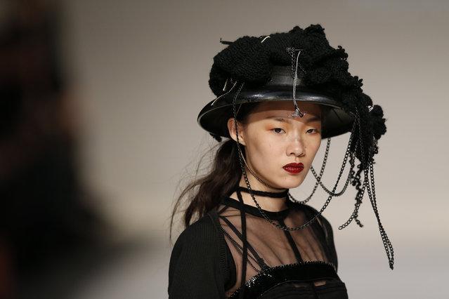 A model presents a creation by Hong Kong designer Sherman Kwan during the Hong Kong Fashion Week for Fall/Winter in Hong Kong, China January 18, 2016. (Photo by Bobby Yip/Reuters)